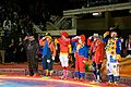 Shriners from the El Maida Shrine, dressed as clowns, render a salute, during the Shriner Circus at the El Paso County Coliseum in El Paso, Texas, Nov. 11, 2012 121111-A-VF572-002.jpg