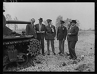 "Baron Baillieu - Left to right: Sir Clive Baillieu of the British Purchasing Commission; A.R. Glancy of the Ordnance Section, Office of Production Management (OPM); Brigadier General B.O. Lewis; Brigadier General G.M. Barnes; Rear Admiral H.A. Sheridan of the British Royal Navy; inspecting the new M-3 ""Medium"" tank currently being manufactured for the Army. Chrysler Tank Arsenal near Detroit, Michigan"
