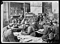Soldiers inside the YMCA library in Beauvois, France, World War I (21422472019).jpg