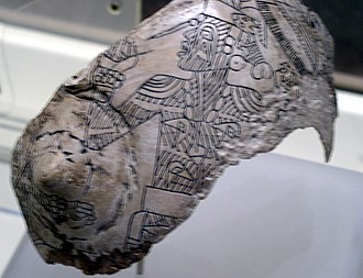 Caddoan Mississippian culture - Engraved whelk shell from the Craig Mound showing a tattooed figure
