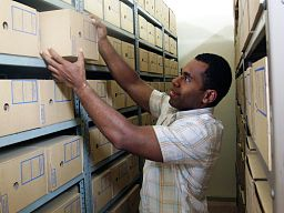 Staff member retrieving files from The National Archives