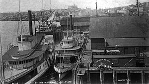 Emma Hayward - Emma Hayward, center (next to pier), moored in Seattle, June 6, 1891.  Large steamer on left is T.J. Potter.