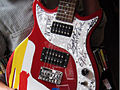 Steve Keene-painted, autographed, First Act electric guitar body 1.jpg