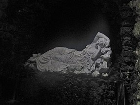 The statue of a sleeping nymph in a grotto at Stourhead gardens, England. Stourhead, Grotto, statue of a sleeping nymph.jpg