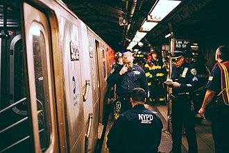 New York City Police Department Emergency Service Unit - ESU officers investigate a subway suicide on the IND Queens Boulevard Line platforms at Lexington Avenue - 53rd Street.