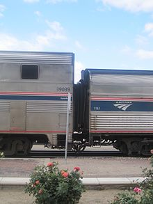 Two silver railcars