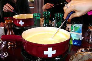 Dipping a cheese fondue with a long-stemmed fork