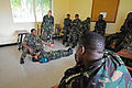 Tanzanian People's Defence Force Capt. Clement Selengia Swai, squatting left, teaches procedures for drags and carries during a tactical combat casualty care course as U.S. Navy Hospital Corpsman 3rd Class 120301-N-RB546-093.jpg