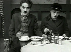The Immigrant (1917 film) - Chaplin and Purviance in the memorable restaurant scene