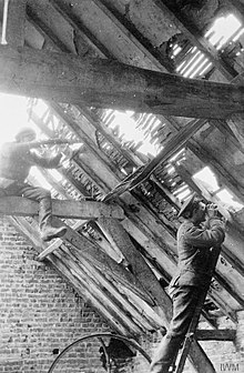 Berkshire territorial sniper team in the loft of a ruined house