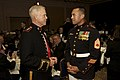 The 35th Commandant of the Marine Corps, Gen. James F. Amos, left, speaks with a Marine Gunnery Sgt. during the 33rd Annual Modern Day Marine Grand Banquet in Pentagon City, Arlington, Va., Sept 130925-M-LU710-253.jpg