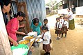 The Children being served the food under the Mid-day Meal Scheme at a primary school, Wokha district in Nagaland.jpg