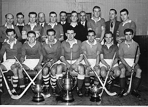 Kilmallie Shinty Club - The Kilmallie team which won the Camanachd Cup in 1964 shown with the cup and other trophies won that season.Back row from Left Jimmy Chisholm, David Cargill, John MacIsaac, Walter Cameron, Hugh MacIntyre, Corrie Sutherland, Alan MacDonald, Iain MacMillan, Dougie MacLaughlan, Joe MacPherson, Charlie Fraser. Front from Left. Iain MacIntosh, James Burnett, Johnny MacMaster,Derek Fraser, Ronald Ferguson, Jimmy Bruce, Donald MacIntyre