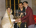 The President, Smt. Pratibha Patil presenting the Arjuna Award -2006 to Shri Rohit Bhaker for Badminton (Disabled Category) at a glittering function, in New Delhi on August 29, 2007.jpg