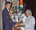 The President Dr. A.P.J. Abdul Kalam presenting the Dronacharya Award -2005 to Shri Ismail Baig for Rowing, at a glittering function in New Delhi on August 29, 2006.jpg