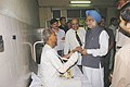 The Prime Minister, Dr. Manmohan Singh consoles an injured person at Lokmanya Tilak Hospital in Mumbai on July 14, 2006 (1).jpg