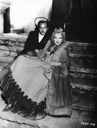 Josef von Sternberg - Josef von Sternberg and Marlene Dietrich, in the costume of Sophie Frederica, on the set of The Scarlett Empress, 1934