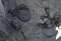 The remains of an explosive device that were used to attack a U.S. convoy are uncovered in the Sarkani district of Kunar province, Afghanistan, Aug. 28, 2010 100828-A-TH742-008.jpg