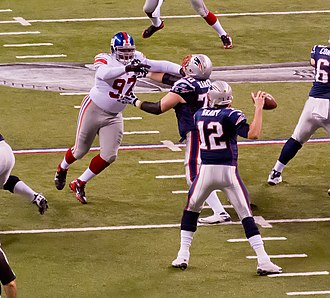 Forward pass - Tom Brady trying to pass before being blocked, 2012