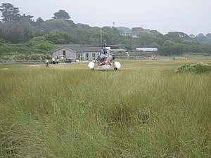 Tresco Heliport - The heliport with one of British International Helicopters' Sikorsky S-61 helicopters on the ramp