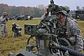 U.S. Army Sgt. Scott Cunningham, foreground, with Alpha Battery, Field Artillery Squadron, 2nd Cavalry Regiment, aligns the sight on an M777 howitzer to the collimator with the help of two Soldiers during 121025-A-TF309-006.jpg