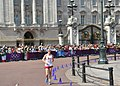 U.S. Army Staff Sgt. John Nunn, a racewalker with the U.S. Olympic Team, races past the Buckingham Palace during the 50-kilometer race walk competition as part of the 2012 Olympic Games in London, United 120811-A-LX473-001.jpg