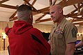 U.S. Marine Corps Sgt. Maj. Micheal P. Barrett, right, the sergeant major of the Marine Corps, receives shooting advice from the 2013 Warrior Games Marine Corps shooting team coach during a practice session for 130512-M-QS647-017.jpg