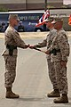 U.S. Marine Corps Sgt. Maj. Troy E. Black accepts the noncommissioned officers sword appointing him as the new sergeant major for the 11th Marine Expeditionary Unit during a post and relief ceremony at Marine 130516-M-BZ222-007.jpg