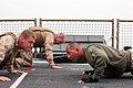 U.S. Marine Corps Staff Sgt. Daniel Ahmed, a Marine Corps Martial Arts Program instructor with the command element assigned to Security Cooperation Task Force Africa Partnership Station 2012, does pushups with 120714-M-JU449-278.jpg