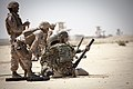 U.S. Marine Corps Staff Sgt. Gustavo Serpa, second from left, with the Regional Corps Battle School, watches as an Afghan National Army (ANA) mortarman shoots off a training practice round at a mortar range near 130504-M-RO295-228.jpg
