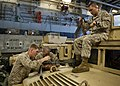 U.S. Marines with the 24th Marine Expeditionary Unit (MEU) clean weapons aboard a landing craft, air cushion in the well deck of the amphibious transport dock ship USS New York (LPD 21) April 12, 2012, while 120412-N-XK513-045.jpg