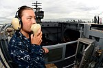 U.S. Navy Aviation Boatswain's Mate (Handling) Airman Destiny Nelson communicates with elevator operators using a sound-powered phone on the flight deck of the aircraft carrier USS Ronald Reagan (CVN 76) 130826-N-HI324-061.jpg