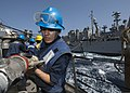 U.S. Navy Boatswain's Mate 3rd Class Alejandra Davila-Valadez, assigned to the guided missile destroyer USS Mason (DDG 87), connects a fuel line from the fast combat support ship USNS Rainier (T-AOE 7) 131110-N-PW661-010.jpg