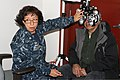 U.S. Navy Lt. Cmdr. Patricia Anderson, an optometrist with the Naval Reserve, performs an eye exam at the Alaska National Guard armory in Nome, Alaska, April 16, 2012 120416-F-ZH346-001.jpg