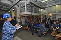 U.S. Navy Ship's Serviceman 1st Class Marquita Canada, left, an in-port emergency team instructor, addresses Sailors during a toxic gas drill aboard the aircraft carrier USS Abraham Lincoln (CVN 72) Oct. 30 131030-N-XP477-003.jpg
