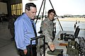 U.S. Sen. Joe Donnelly, left, talks with Army Spc. Traci Standifer, a search and extraction team member with the 19th Chemical, Biological, Radiological, Nuclear and Explosive Enhanced Response Force Package 130828-Z-PM441-845.jpg