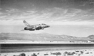United Airlines Flight 736 - Image: USAF F 100 Super Sabre fighter taking off from Nellis AFB Nevada circa 1959