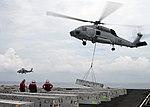 USS Nimitz takes on supplies DVIDS319410.jpg