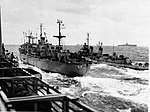 USS Regulus (AF-57) with O'Bannon (DD-450) 1956.jpg