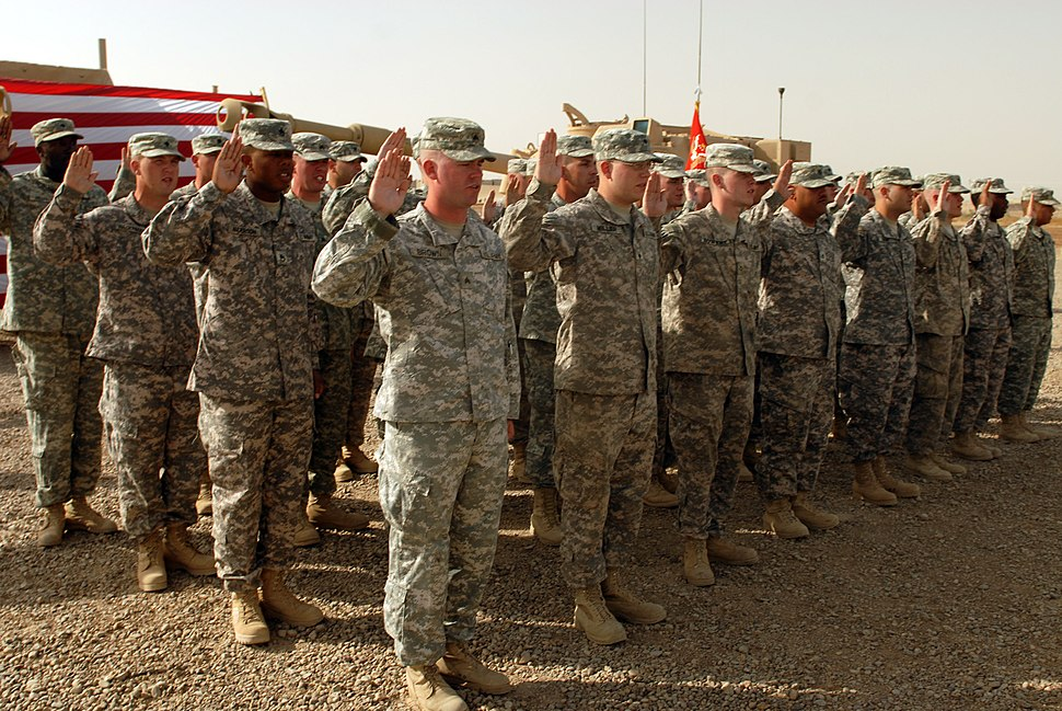 US Army 52421 CAMP TAJI, Iraq - Forty-one Soldiers of the 1st Battalion, 82nd Field Artillery Regiment, 1st Brigade Combat Team, 1st Cavalry Division, raise their right hands during a re-enlistment ceremony held at