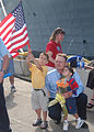 US Navy 030726-N-9214G-119 Family and loved ones anxiously wait as the amphibious dock landing ship USS Pearl Harbor (LSD 52) pulls into her berth.jpg