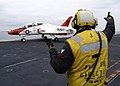 US Navy 040623-N-6817C-040 An Aviation Boatswain's Mate directs a T-45A Goshawk assigned to Training Air Wing Two (TW-2) on the flight deck of USS Abraham Lincoln (CVN 72).jpg