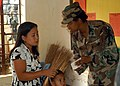 US Navy 050218-N-6775N-055 U.S. Army Sgt. Teresa Boyd explains the proper dosage of medication to a local Filipino woman at Nakar Elementary School during exercise Balikatan 2005 in Nakar, Philippines.jpg