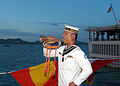 US Navy 050621-N-4104L-040 A Royal Thai Navy bugler aboard HTMS Phutthayotfa Chulalok sounds a call marking evening colors A Royal Thai Navy bugler aboard HTMS Phutthayotfa Chulalok sounds a call marking evening colors.jpg