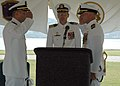 US Navy 050803-N-2820Z-001 Cmdr. Michael B. Portland, right, relieves Cmdr. Robert P. Burke during the change of command ceremony for the Los Angeles-class fast attack submarine USS Hampton (SSN 767) at Hospital Point in Portsm.jpg