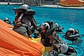 US Navy 050927-N-7286M-016 Navy air crewman help each other into a 12-man life raft to await a simulated rescue in the pool at Aviation Survival Training Center (ASTC) Miramar.jpg