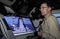 US Navy 051104-N-4776G-158 Commanding Officer, USS Ronald Reagan (CVN 76), Capt. James Symonds, oversees an underway replenishment on the navigation bridge.jpg