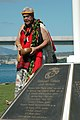 US Navy 051114-N-3019M-006 A native Hawaiian performs a blessing during a ceremony dedicating a new flagstaff and display of bronze plaques commemorating 73 Marines who gave their lives and 15 survivors of the attack on the bat.jpg