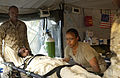 US Navy 051120-F-2729L-003 U.S. Navy Hospitalman Lashen Washington, left, and Hospital Corpsman 3rd Class Althea Caraballo lift a patient onto a litter at the field hospital in Shinkiari, Pakistan.jpg