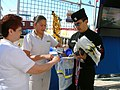 US Navy 060226-N-8374E-002 Aviation Electronics Mate 2nd Class Jerry J. Jimenez, assigned to Navy Recruiting Station Lake Jackson, Texas, tells visitors about Navy careers as they select promotional items.jpg